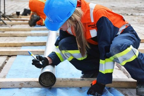 Female TransGas employee working on the job site